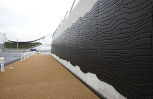 LOGOC Embossed, punched, bronze anodised cladding